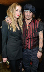 rs_634x1024-160215203801-634-amber-heard-johnny-depp-accepting-award-show-21516